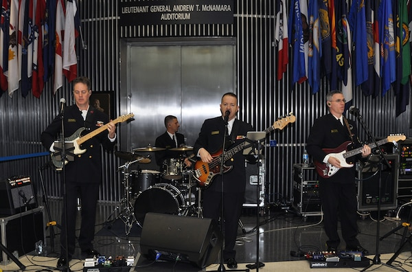 The U.S. Naval Academy Electric Brigade band entertains McNamara Headquarters Complex employees during the holiday social Dec. 9.