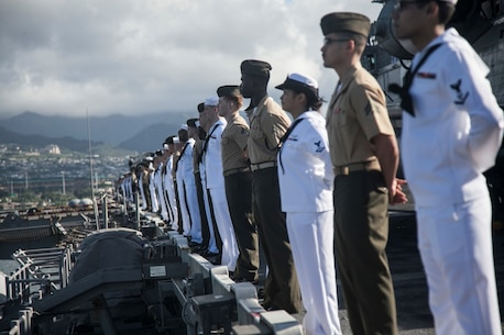 PEARL HARBOR, Hawaii (Dec. 3, 2015) U.S. Marines and man the rails while aboard the USS Essex (LHD-2) while pulling into port in Hawaii.  Hawaii is the 15th Marine Expeditionary Unit's last port call before heading home after their WESTPAC 15 deployment. (U.S. Marine Corps photo by Sgt. Elize McKelvey/Released)