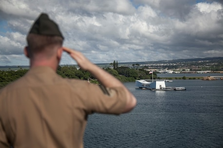 PEARL HARBOR, Hawaii (Dec. 3, 2015) A U.S. Marine with the 15th Marine Expeditionary Unit pays respect to the USS Arizona while manning the rails on the flight deck of the USS Essex (LHD-2).  Hawaii is the 15th Marine Expeditionary Unit's last port call before heading home after their WESTPAC 15 deployment. (U.S. Marine Corps photo by Sgt. Elize McKelvey/Released)