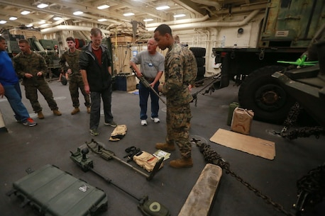 PACIFIC OCEAN (Dec. 9, 2015) U.S. Marine Sgt. Aaron Reed explains the equipment he uses as a combat engineer aboard the USS Anchorage (LPD 23). Reed is a combat engineer with Combat Logistic Battalion 15, 15th Marine Expeditionary Unit. The 15th MEU is coming to the end of deployment and hosting a Tiger Cruise for family members to showcase life aboard the Anchorage. (U.S. Marine Corps photo by Sgt. Steve H. Lopez/Released)