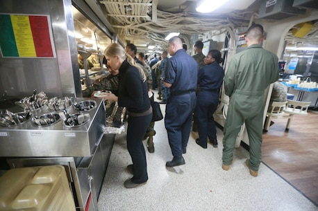 PACIFIC OCEAN (Dec. 9, 2015) U.S. Marines with the 15th Marine Expeditionary Unit and family enjoy an ice cream social aboard the USS Anchorage (LPD 23). The 15th MEU is coming to the end of deployment and hosting a Tiger Cruise for family members to showcase life aboard the Anchorage. (U.S. Marine Corps photo by Sgt. Steve H. Lopez/Released)
