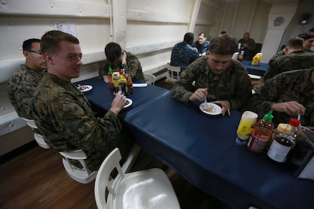 PACIFIC OCEAN (Dec. 9, 2015) U.S. Marines with the 15th Marine Expeditionary Unit enjoy an ice cream social aboard the USS Anchorage (LPD 23). The 15th MEU is coming to the end of deployment and hosting a Tiger Cruise for family members to showcase life aboard the Anchorage. (U.S. Marine Corps photo by Sgt. Steve H. Lopez/Released)