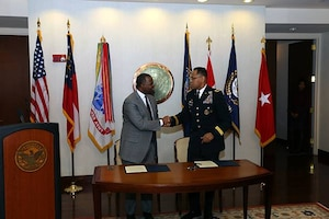 South Atlantic Division and City of Atlanta on October 4 signed an agreement to jointly fund and pursue a 3-year feasibility study to address environmental and flooding problems in the Proctor Creek basin in the city. The project is innovative in that it seeks an integrated approach to a wide array of problems and involves extensive partnerships with other agencies and community groups.  Mayor Kasim Reed signed for the city, while BG C. David Turner, SAD commander, signed for USACE. The study will be conducted by the Mobile District.