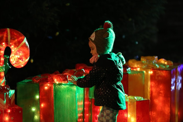 A child looks at Christmas decorations during the 27th Annual Tree Lighting Ceremony aboard Laurel Bay Dec. 3. The event was held to kick off the holiday season for service members and their families. Entertainment was provided by the students of Bolden Elementary School, and was hosted by members of Marine Corps Community Services.