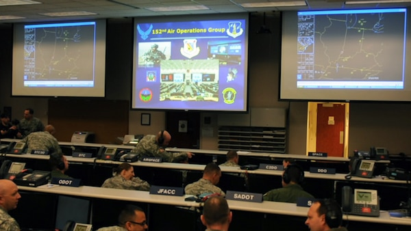 Airmen of the New York Air National Guard's 152nd Air Operations Group man their stations during Virtual Flag, a computer wargame held Feb. 18-26 from Hancock Field Air National Guard Base. The computer hookup allowed the air war planners of the 152nd to interact with other Air Force units around the country and in Europe. U.S. Air National Guard photo by Master Sgt. Eric Miller
