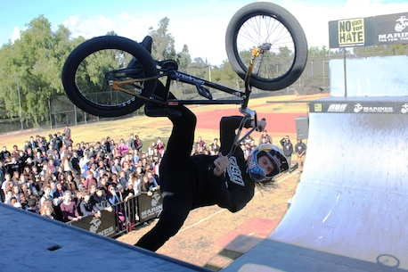 "BMX biker Coco Zurita performs a stunt in front of hundreds of students at Calabasas High School during the 2015 ASA High School Tour, Dec. 11. The tour is an interactive ""extreme"" sports show that visits high schools throughout the United States with several of the world's top professional skateboarders, BMX bikers and inline skaters delivering an anti-bullying and anti-tobacco message. Recruiters from Recruiting Sub Station Granada Hills also attended the event and held a pull-up and flexed-arm hang challenge. (U.S. Marine Corps photo by Staff Sgt. Alicia R. Leaders/Released)"