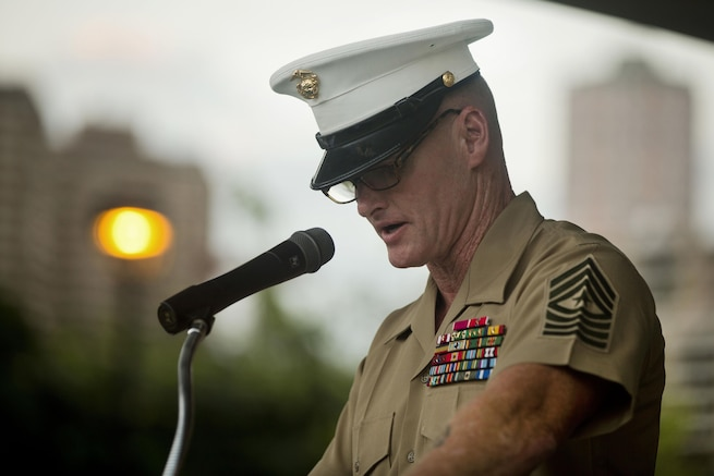 Marine Sgt. Maj. Paul S. McKenna of Marine Corps Forces Pacific delivers remarks during the opening ceremony of the Pearl Harbor Memorial Parade at Fort DeRussy Park in Honolulu, Dec. 7, 2015. Veterans, service members and others marked the 74th anniversary of the attacks on Pearl Harbor and paid respects to those who fought and lost their lives. U.S. Marine Corps photo by Lance Cpl. Miguel Rosales