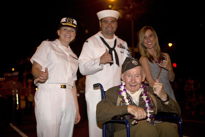 World War II veteran Joe Reilly, a survivor of the attacks on Pearl Harbor, poses for a photograph during the Pearl Harbor Memorial Parade at Fort DeRussy Park in Honolulu, Dec. 7, 2015. U.S. Marine Corps photo by Lance Cpl. Miguel Rosales