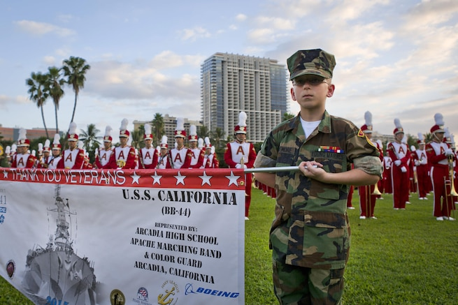 Raven Pridemore, a private in the Young Marines, carries a banner during the opening ceremony of the Pearl Harbor Memorial Parade on Fort DeRussy Park in Honolulu, Dec. 7, 2015. U.S. Marine Corps photo by Lance Cpl. Miguel Rosales