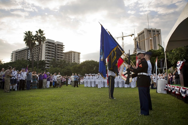 A joint color guard presents the colors during the opening ceremony of the Pearl Harbor Memorial Parade on Fort DeRussy Park, in Honolulu Dec. 7, 2015. U.S. Marine Corps photo by Lance Cpl. Miguel Rosales