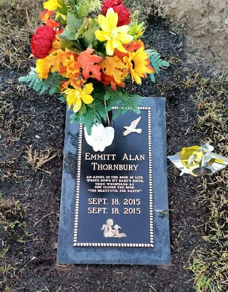 A picture shows the headstone of Emmitt Alan Thornbury, son of Airman 1st Class Christopher Thornbury, 22nd Air Refueling Wing Public Affairs photojournalist, laid to rest in Lebanon, Mo. Emmitt passed away as a result of his deformities caused by his condition, Trisomy 18. (Courtesy photo)