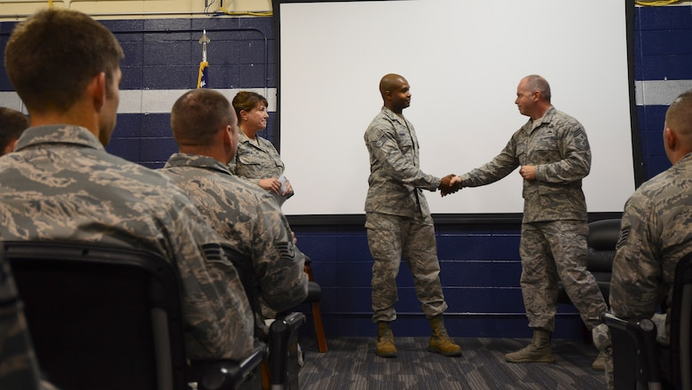 Chief Master Sgt. James W. Hotaling, command chief master sergeant of the Air National Guard, visited the 128th Air Refueling Wing at General Mitchell International Airport Dec. 5, 2015. During the visit Hotaling recognized Staff Sgt. Keith Turner, an Airman with the 128th Communications Flight, for outstanding service with the Rising Six Enlisted Council. (U.S. Air National Guard photo by Tech. Sgt. Meghan Skrepenski/Released)