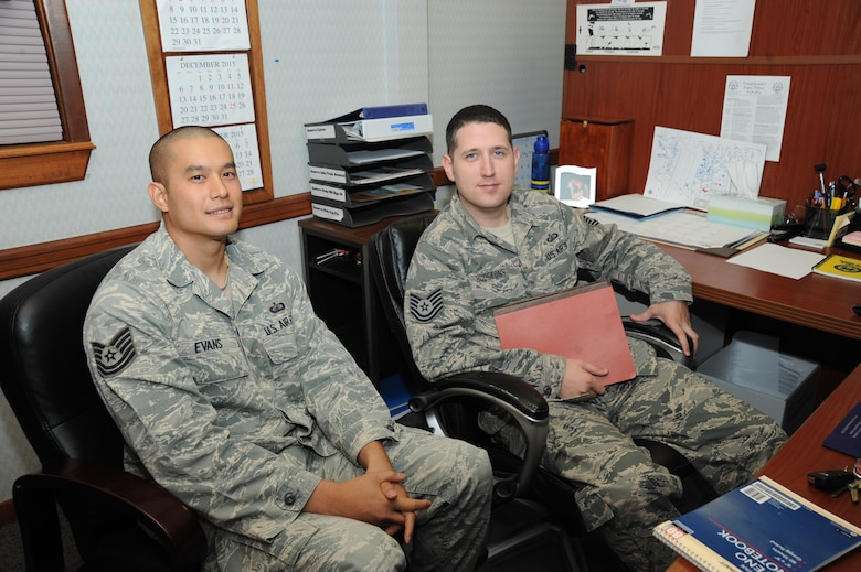 Tech. Sgt. Rungkun Evans, and John Hudgeons, 22nd Air Refueling Wing Director of Staff unit deployment managers, pose for a photo, Nov. 25, 2015, at McConnell Air Force Base, Kan. UDMs manage the deployment process and provide individuals with the necessary knowledge and resources. (U.S. Air Force/Airman Jenna K. Caldwell)
