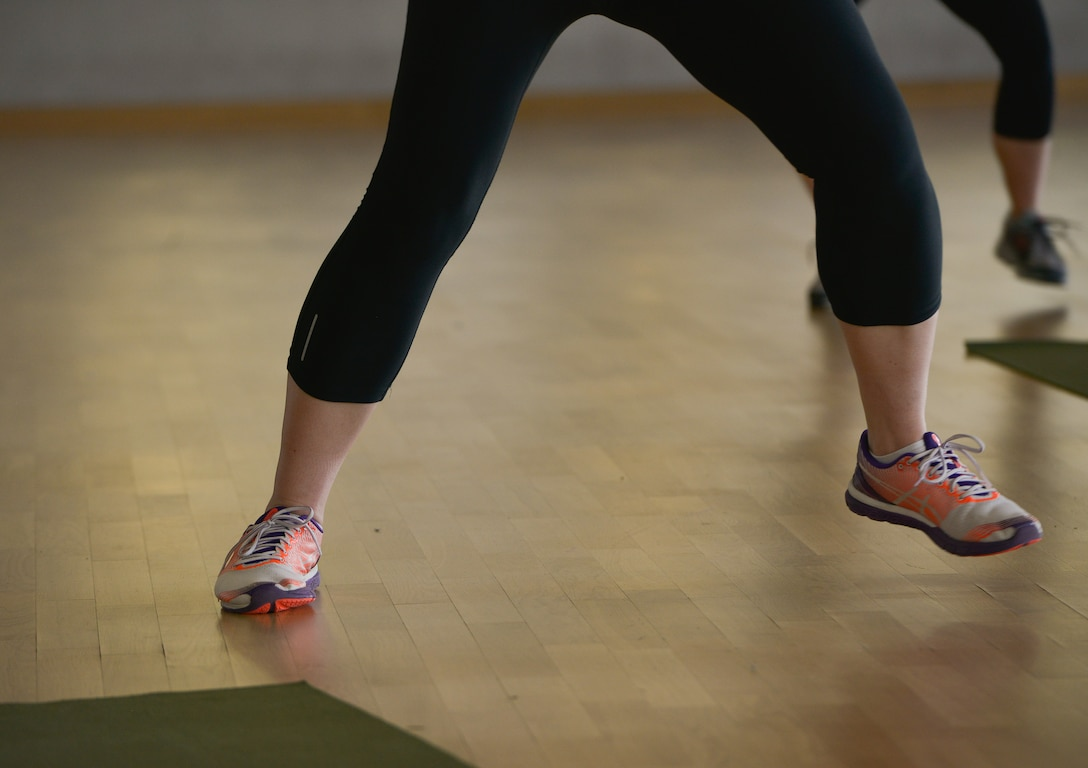 A Tabata class participant sidesteps during a class at the Ramstein Southside Fitness Center Dec. 7, 2015, at Ramstein Air Base, Germany. The fitness center offers several different classes people can use to help them obtain their fitness goals. (U.S. Air Force photo/Airman 1st Class Lane T. Plummer)