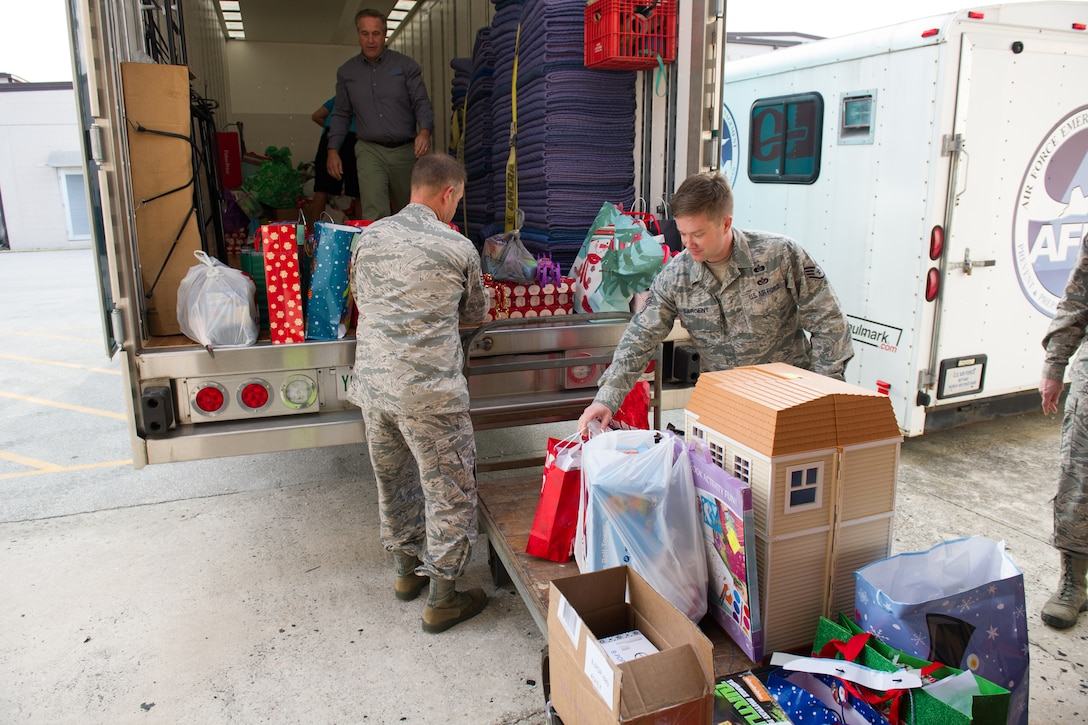 The Patrick AFB and Cape Canaveral AFS First Sergeant's Council collected more than 600 toys, and donated to the Brevard Family Partnership for an annual toy drive in support of children in foster care, Dec. 8, 2015, at Patrick Air Force Base, Fla. Each year, the Brevard Family Partnership relies on numerous organizations and companies to support the event, which made for a total estimate value of $8,000. (U.S. Air Force photo/Benjamin Thacker) (Released)