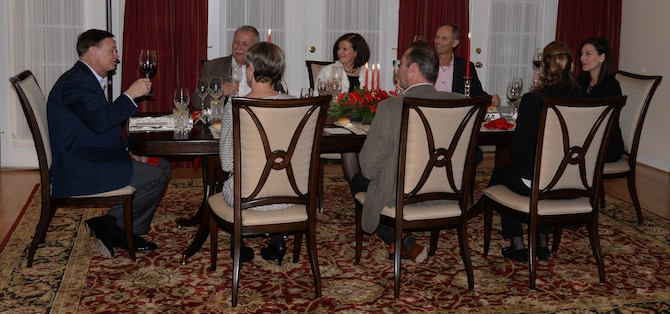 Air Force District of Washington Commander Maj. Gen. Darryl Burke offers a toast to begin a dinner with Air Attachés from Germany, Denmark, and Belgium Dec. 10, 2015. Burke hosted the Air Attachés at his residence to help build and sustain relationships between the U.S. and their respective countries. Air Force District of Washington provides manpower, personnel and services support for designated Air Force activities within the National Capital Region and for more than 26,000 Airmen performing duties worldwide in 108 countries. (U.S. Air Force Photo/1 Lt. Esther Willett)
