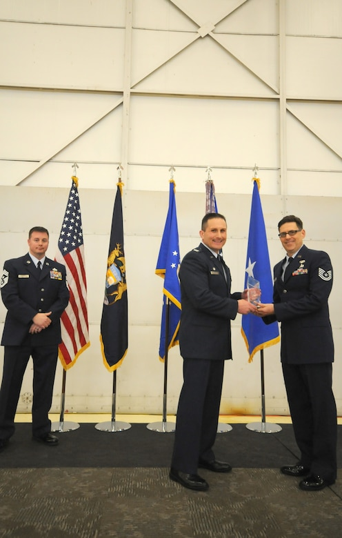 Col. Bryan Teff announces and congratulates the 2015 Airman of the Year recipients, Saturday, December 5, 2015, Battle Creek Air National Guard Base, Mich. Members awarded include, Airman of the Year, Senior Airman Erik Elliot, 110th Operations Support Squadron, Non-Commissioned Officer of Year, Tech. Sgt. Richard Parker II, 217th Air Component Operations Squadron, Senior Non-Commissioned Officer of the Year, Master Sgt. Carl Westphal II, 217th Air Operations Squadron, Company Grade Officer of the Year, 1st Lt. Justin Andrews, 217th Air Component Operations Squadron, 1st Sgt. of the Year, Master Sgt. Darrell Kingsbury, 217th Air Operations Group, Honor Guard Member of the Year, Staff Sgt. Amanda Bean, Battle Creek Air National Guard Enlisted Memorial Scholarship recipient, Jacob Zahm, annual 110th Attack Wing Outstanding Unit Safety Representative, Master Sgt. Felica Harris, and Outstanding Individual Safety Contribution, Master Sgt. Luke Wimby, and 110th Attack Wing Guardsman of the year, Staff Sgt. Amanda Bean. (Air National Guard Photo by Master Sgt. Sonia Pawloski/released)