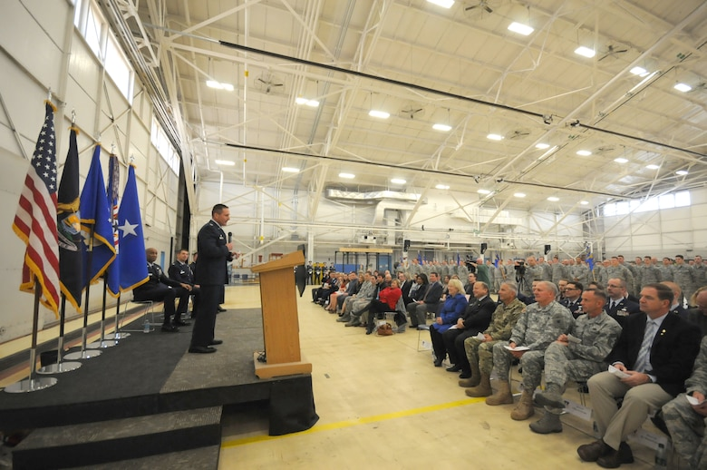 Col. Bryan Teff assumes command of the 110th Attack Wing, Battle Creek Air National Guard Base, Mich., Saturday, December 5, 2015 in the hangar of the Wing. Teff will be taking over the role of commander from Col. Ronald Wilson who has been the wing commander for three years. (Air National Guard Photo by Master Sgt. Sonia Pawloski/released)