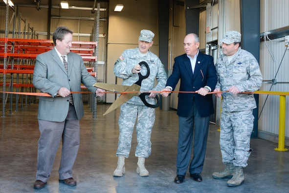 From left: Bill Falkner, mayor of St. Joseph, U.S. Army Maj. Gen. Stephen L. Danner, the adjutant general of the Missouri National Guard, Harry Roberts, presiding commissioner of Buchanan County, and U.S. Air Force Col. Ralph Schwader, commander of the 139th Airlift Wing, attend a ribbon cutting ceremony at Rosecrans Air National Guard Base, St. Joseph, Mo., Dec. 10, 2015. The ceremony was for the opening of the 139th Airlift Wing's new security forces building. The building is 6,000 square feet and will be used by the 139th Security Forces Squadron which is responsible for protecting the wing's personnel and property. (U.S. Air National Guard photo by Tech. Sgt. Michael Crane)