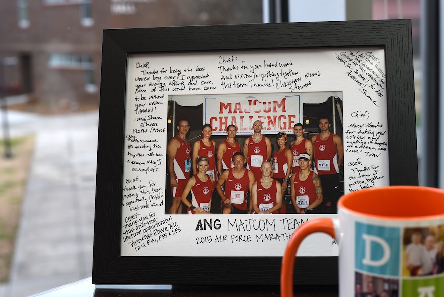 MCGHEE TYSON AIR NATIONAL GUARD BASE, Tenn. - A photo, autographed by Airmen on the Air National Guard's 2015 U.S. Air Force Marathon team, overlooks the I.G. Brown Training and Education Center campus here Dec. 11, 2015, atop Chief Master Sgt. Edward Walden's desk. Walden, TEC's commandant, managed the runners. They earned second place among other major commands that competed on Wright-Patterson Air Force Base in Ohio. (U.S. Air National Guard photo by Master Sgt. Mike R. Smith/Released)