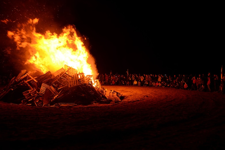 Boy Scout troops view the bonfire at McEntire Joint National Guard Base, S.C., during the Swamp Fox Camporee Dec. 6, 2015. The event was hosted by the South Carolina National Guard to allow Cub Scouts and Boy Scouts the opportunity to interact with Guardsmen and compete to earn various merit badges. (U.S. Air National Guard photo by Airman Megan Floyd/RELEASED)
