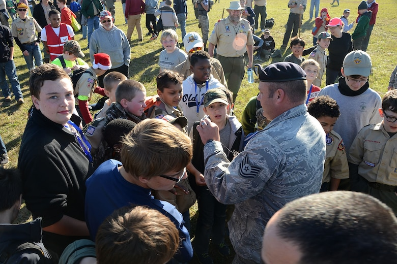 U.S. Air Force Tech Sgt. Ismael Fierro, a combat arms instructor with the 169th Security Forces Squadron, shows Boy Scouts what the pins on a Taser stun gun look like during the Swamp Fox Camporee at McEntire Joint National Guard Base, S.C., Dec. 5, 2015. The event was hosted by the South Carolina National Guard to allow Cub Scouts and Boy Scouts the opportunity to interact with Guardsmen and compete to earn various merit badges. (U.S. Air National Guard photo by Airman Megan Floyd/RELEASED)