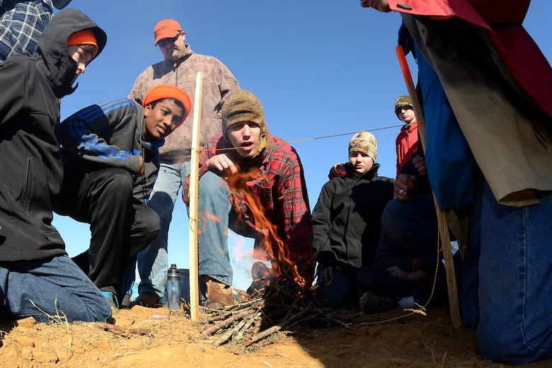 Boy Scouts with Troop 429 participate in a string burning competition during the Swamp Fox Camporee at McEntire Joint National Guard Base, S.C., Dec. 5, 2015. The event was hosted by the South Carolina National Guard to allow Cub Scouts and Boy Scouts the opportunity to interact with Guardsmen and compete to earn various merit badges. (U.S. Air National Guard photo by Airman Megan Floyd/RELEASED)