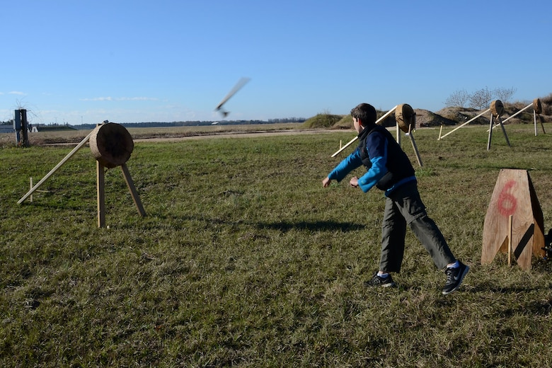 Ethan Adams, a Boy Scout with Troop 100, practices for the tomahawk throwing contest during the Swamp Fox Camporee at McEntire Joint National Guard Base, S.C., Dec. 5, 2015. The event was hosted by the South Carolina National Guard to allow Cub Scouts and Boy Scouts the opportunity to interact with Guardsmen and compete to earn various merit badges. (U.S. Air National Guard photo by Airman Megan Floyd/RELEASED)