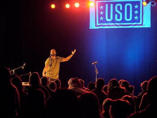 Comedian Sydney Castillo performs during the 2015 USO Holiday Troop Tour Dec. 9, 2015, at Ramstein Air Base, Germany. Castillo and other celebrities joined U.S. Marine Corps Gen. Joseph F. Dunford, chairman of the Joint Chiefs of Staff, as a way to show thanks to service members and their families. (U.S. Air Force photo/Staff Sgt. Timothy Moore)