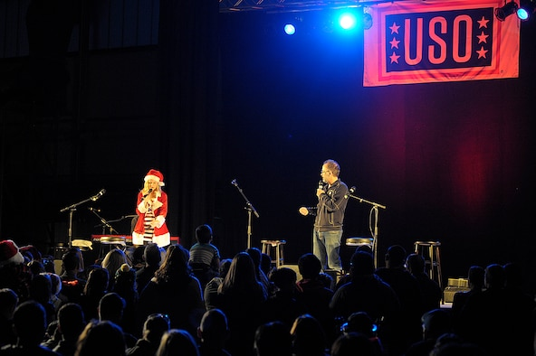 Actors Elizabeth Banks and David Wain talk with the crowd during the 2015 USO Holiday Troop Tour Dec. 9, 2015, at Ramstein Air Base, Germany. Ramstein was the last stop of the 15th annual tour. (U.S. Air Force photo/Staff Sgt. Timothy Moore)
