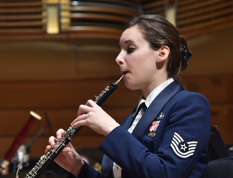 Tech. Sgt. Emily Snyder, U.S. Air Force Concert Band member, plays oboe during a Concert Band performance at the Strathmore Theatre in Bethesda, Md., Dec 1, 2015. The Air Force Band is the Air Force's premier musical organization. The excellence demonstrated by the Band's Airmen is a reflection of the excellence carried out 24 hours a day by Airmen stationed around the globe. (U.S. Air Force photo/ Airman 1st Class J.D. Maidens/ released)