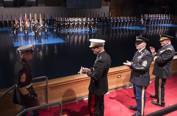 Marine Corps Gen.  Joseph F. Dunford Jr., center left, chairman of the Joint Chiefs of Staff, Army Command Sgt. Maj. John W. Troxell, center right, incoming senior enlisted advisor to the chairman of the Joint Chiefs of Staff, and retired Army Gen. Martin E. Dempsey, 18th chairman of the Joint Chiefs of Staff, greet Marine Corps Sgt. Maj. Bryan B. Battaglia, retiring senior enlisted advisor to the chairman during a retirement and change of responsibility ceremony on Joint Base Myer-Henderson Hall, Va., Dec. 11, 2015. DoD photo by Navy Petty Officer 2nd Class Dominique A. Pineiro