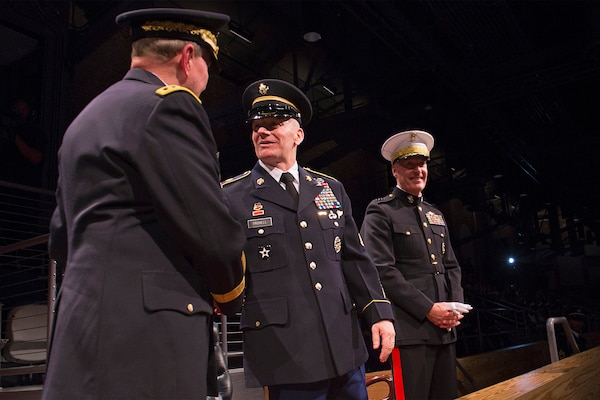 Army Command Sgt. Maj. John W. Troxell, the third senior enlisted advisor to the chairman of the Joint Chiefs of Staff, greets retired Army Gen. Martin E. Dempsey, 18th chairman of the Joint Chiefs of Staff, during a change of responsibility ceremony on Joint Base Myer-Henderson Hall, Va., Dec. 11, 2015. DoD photo by Navy Petty Officer 2nd Class Dominique A. Pineiro