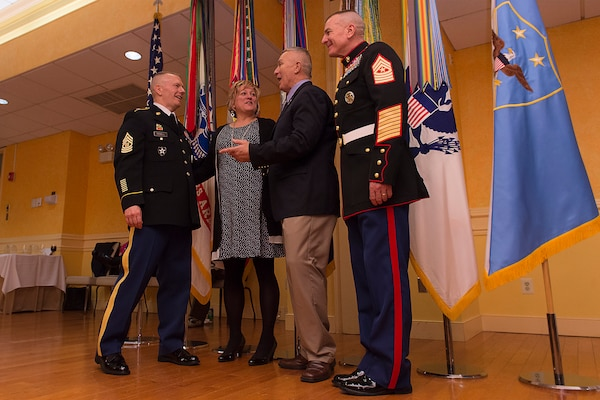 Army Command Sgt. Maj. John W. Troxell, third senior enlisted advisor to the chairman of the Joint Chiefs of Staff, introduces his sister to the first senior enlisted advisor to the chairman, retired Army Sgt. Maj. Joe Gainey, and recently retired Marine Corps Sgt. Maj. Bryan B. Battaglia, the second senior enlisted advisor to the chairman, during a reception following the change of responsibility ceremony on Joint Base Myer-Henderson Hall, Va., Dec. 11, 2015. DoD photo by Navy Petty Officer 2nd Class Dominique A. Pineiro