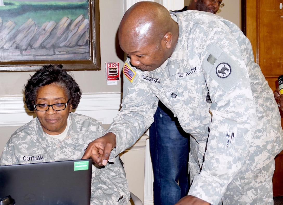 SFC Lloyd Robertson, Retirement Services NCOIC for the 81st Regional Support Command assists MSG Loretta Cotham of the 5th Medical Brigade in Birmingham, Ala., with benefits registration. The 81st RSC presented a Pre-Retirement Services brief at the Lexington, Ky. VA Medical Center Dec. 5. The 81st RSC hopes to partner with the VA for all future briefs in order to provide better service to retiring service members.