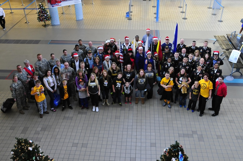 Nine families from the Pittsburgh area arrived at the Pittsburgh International Airport Dec. 12, 2015, to start their journey on the Snowball Express. The families posed with service members from the Army Reserve, the Pennsylvania National Guard and the Pennsylvania Patriot Guard Riders. The Snowball Express concept was developed 10 years ago with the goal of bringing new hope and happy memories to the families of military heroes who have lost their lives since Sept. 11 2001. (U.S. Army photo by Sgt. Christopher Bigelow / released)