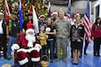 Gold Star family members Laura and Benjamin Forshey pose with Santa Claus and service members from the Army Reserve and Pennsylvania National Guard at the Pittsburgh International Airport Dec. 12, 2015. The Forshey's, along with nine other families from the Pennsylvania area were at the airport to start their journey on the Snowball Express. The Snowball Express concept was developed 10 years ago with the goal of bringing new hope and happy memories to the families of military heroes who have lost their lives since Sept. 11 2001. (U.S. Army photo by Sgt. Christopher Bigelow / released)