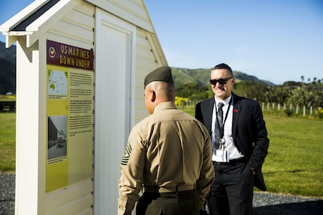 Lt Col. John W. Black takes time, Nov. 19, 2015, to show Sgt. Maj. Vincent C. Santiago the old living quarters, nearby Wellington, New Zealand, where the Marines of 1st Marine Division stayed during World War II. Santiago, from Merizo, Guam, is the sergeant major for 3rd Marine Division, III Marine Expeditionary Force. Black, from Stockton, California, works at the U.S. embassy in New Zealand. (U.S. Marine Corps photo by Cpl. Tyler S. Giguere/Released)