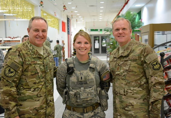 Gen. Mark Welsh III, Chief of Staff of the Air Force (left), poses for a picture with 1st Lt. Meghan Eckenrode, 379th Expeditionary Security Forces Squadron (center) and Chief Master Sgt. of the Air Force, James Cody (right), in the Blatchford-Preston Complex Dining Facility at Al Udeid Air Base, Qatar Dec. 11. Welsh and Cody met with Airmen during their visit to AUAB and thanked them for their service. (U.S. Air Force photo by Tech. Sgt. James Hodgman/Released)