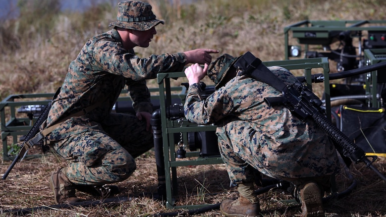Lance Cpl. Quentin J. Stallings, left, and Lance Cpl. Kyle H. Clemens, right, configure the settings on a water pump and filter at Marine Corps Auxiliary Landing Field Bogue, N.C., Dec. 9, 2015. Marines with Marine Wing Support Squadron 271's Engineer Company participated in a cantonment and capabilities field exercise to practice and improve their knowledge of their jobs while in a deployed environment. The weeklong exercise featured events such as airfield damage repair, water purification, medium and heavy lifting missions, with the construction of an expedient road for a vertical take-off and landing aircraft pad. Stallings and Clemens are both water support technicians with MWSS-271.