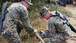 Lance Cpl. Quentin J. Stallings, left, and Lance Cpl. Kyle H. Clemens, right, configure the settings on a water pump and filter at Marine Corps Auxiliary Landing Field Bogue, N.C., Dec. 9, 2015. Marines with Marine Wing Support Squadron 271's Engineer Company participated in a cantonment and capabilities field exercise to practice and improve their knowledge of their jobs while in a deployed environment. The week-long exercise featured events such as airfield damage repair, water purification, medium and heavy lifting missions, with the construction of an expedient road for a vertical take-off and landing aircraft pad. Stallings and Clemens are both water support technicians with MWSS-271.