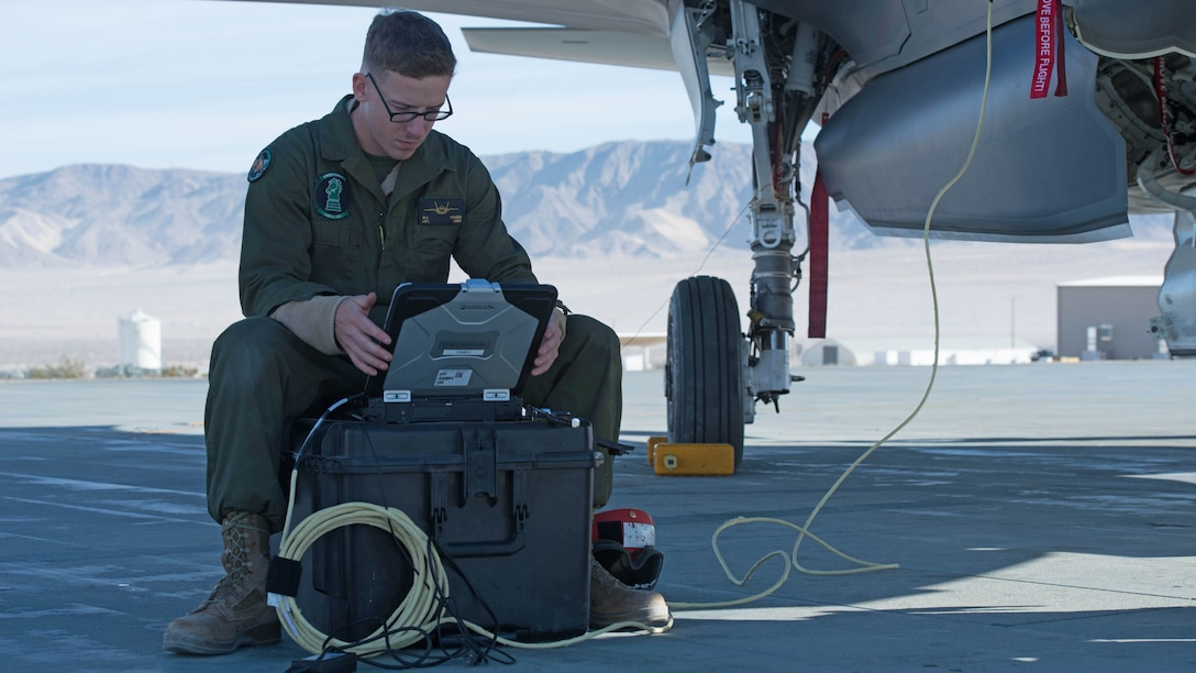 Cpl. Brandon Nordlund performs a weapons functional test on an F-35B Lightning II aircraft during Exercise Steel Knight at Marine Corps Air Ground Combat Center Twentynine Palms, California, Dec. 10, 2015. Nordlund is an avionics technician with Marine Fighter Attack Squadron 121. The F-35B is a single seat, single engine stealth multi-role fighter bringing the Marine Corps into a whole new generation of aircraft. Exercise Steel Knight allowed for VMFA-121 and Marine Operational and Test Evaluation Squadron 22 to train on integrating the F-35B and find its place in the Marine Air Ground Task Force, while giving the ground forces of 1st Marine Division the ability to become familiar with it.
