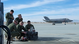 Marines perform a weapons functional test on an F-35B Lightning II aircraft during Exercise Steel Knight at Marine Corps Air Ground Combat Center Twentynine Palms, California, Dec. 10, 2015. The F-35B is a single seat, single engine stealth multi-role fighter bringing the Marine Corps into a whole new generation of aircraft. Exercise Steel Knight allowed for Marine Fighter Attack Squadron 121 and Marine Operational and Test Evaluation Squadron 22 to train on integrating the F-35B and find its place in the Marine Air Ground Task Force, while giving the ground forces of 1st Marine Division the ability to become familiar with it.