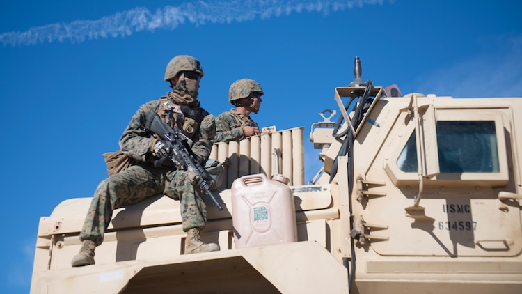 Marines hold security during maintenance on a mine resistant ambush-protected vehicle as a part of Exercise Steel Knight at Marine Corps Air Ground Combat Center Twentynine Palms, California, Dec. 12, 2015. The Marines are with 1st Combat Engineer Battalion. During route clearance Marines use a variety of vehicles to search for improvised explosive devices, mines and other dangerous obstructions. Steel Knight is a 1st Marine Division led exercise, which enables the Marines and sailors to operate in a realistic environment to develop skill sets necessary to maintain a fully capable Marine Air Ground Task Force.