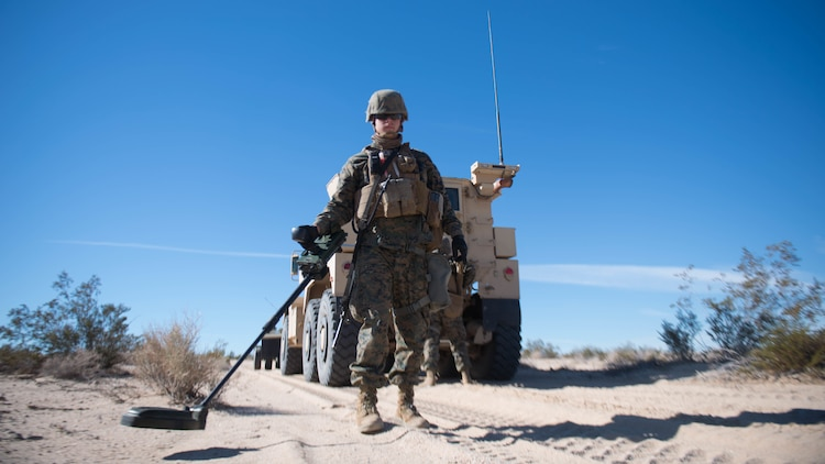 A Marine scans for improvised explosive devices during Exercise Steel Knight at Marine Corps Air Ground Combat Center Twentynine Palms, California, Dec. 13, 2015.  The Marines are with 1st Combat Engineer Battalion. During route clearance Marines use a variety of vehicles to search for improvised explosive devices, mines and other dangerous obstructions. Steel Knight is a 1st Marine Division led exercise, which enables the Marines and sailors to operate in a realistic environment to develop skill sets necessary to maintain a fully capable Marine Air Ground Task Force.