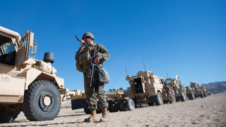 Staff Sgt. Jason Fair prepares for a route clearance drill during Exercise Steel Knight at Marine Corps Air Ground Combat Center Twentynine Palms, California, Dec. 13, 2015. Fair is with 1st Combat Engineer Battalion. During route clearance Marines use a variety of vehicles to search for improvised explosive devices, mines and other dangerous obstructions. Steel Knight is a 1st Marine Division led exercise, which enables the Marines and sailors to operate in a realistic environment to develop skill sets necessary to maintain a fully capable Marine Air Ground Task Force.