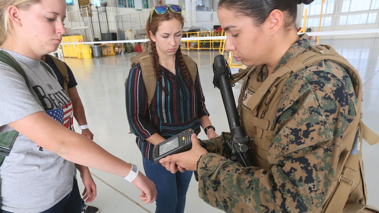 Cpl. Candice Lopez, a U.S. Marine with the 13th Marine Expeditionary Unit, scans the identification bands of evacuees, preparing them to be flown to a safe haven during a simulated noncombatant evacuation as part of Certification Exercise, Dec. 8, 2015. Noncombatant evacuations are one of the MEU's mission essential tasks, which it is specially trained to complete anywhere in the world within hours of notification. CERTEX is the final evaluation of the 13th Marine Expeditionary Unit and Boxer ARG prior to deployment and is intended to certify their readiness to conduct integrated missions across the full spectrum of military operations.