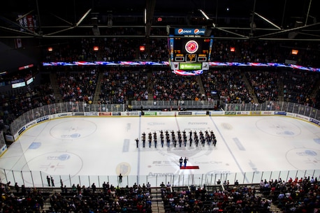 Marine Corps Poolees from Recruiting Sub-Station Grand Rapids South conduct a swear-in ceremony, led by Capt. Tracey Smith, Recruiting Station Lansing, Mich., executive officer, on the ice inside Van Andel Arena during the Grand Rapids Griffins hockey game, Dec. 9, 2015. According to Master Sgt. Kenneth Murillo, RS Lansing, RSS Grand Rapids South staff noncommissioned officer-in-charge, events like this are key in showing the Poolees they have their community's support in their decision to join the United States Marine Corps and it helps keep them motivated.