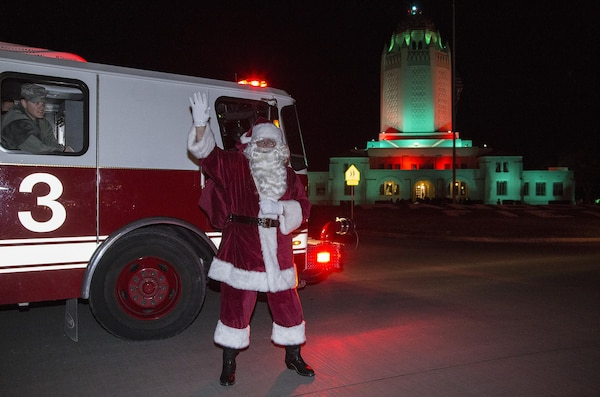 Santa Claus arrived in style Dec. 3 for the Joint Base San Antonio-Randolph tree lighting ceremony.  He was driven in aboard one of Randolph's fire trucks.  After his arrival, he led the children to the Taj, Bldg. 100, for photos and hot cocoa.  The annual event featured a new 36-foot tree, as well as Christmas carols from the Randolph High School Band and Randolph Elementary School Choir.