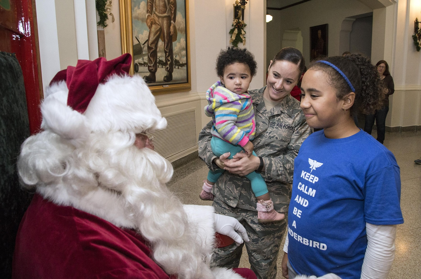 Family photo Master Sgt. Mary Clark from the Air Force Personnel Center,  brought her daughters, Kyra and Jordyn for photos with Santa Claus Dec. 3 in the Taj.  Santa posed for photos following the Joint Base San Antonio-Randolph  tree lighting ceremony Dec. 3.  About 300 people were in attendance for the event, with the Randolph High School Band and Randolph Elementary School choir providing holiday music in anticipation of Santa's arrival.
